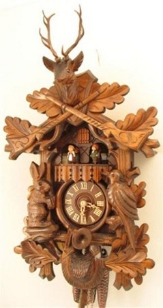 Romba Cuckoo Clock, Musical Hunting, Animated Dancers, Model #1330    This traditional hunting cuckoo clock has beautiful deep carvings with animals out at the hunt along side guns, hunting horn, and ammunition pouch. The dancers are animated. The hands, numbers, and cuckoo bird are all of solid wood.     This Hunting Model is by Rombach und Haas and is available through Cuckoo Kingdom, Inc. This is a museum piece with lush and incredibly detailed carvings.