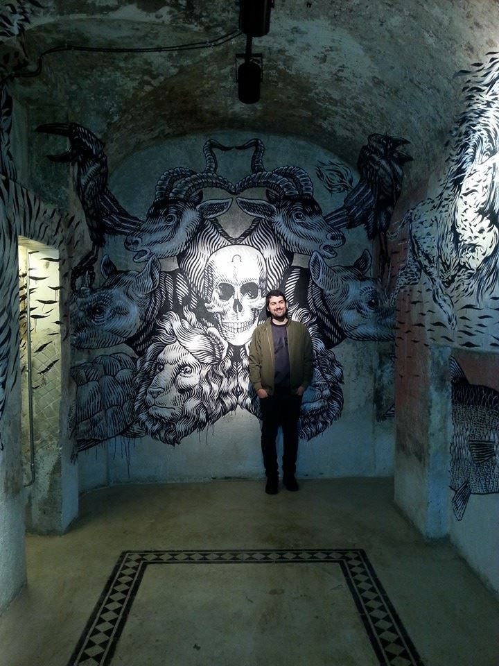 Lucamaleonte with his mural inside Sacripante Gallery.