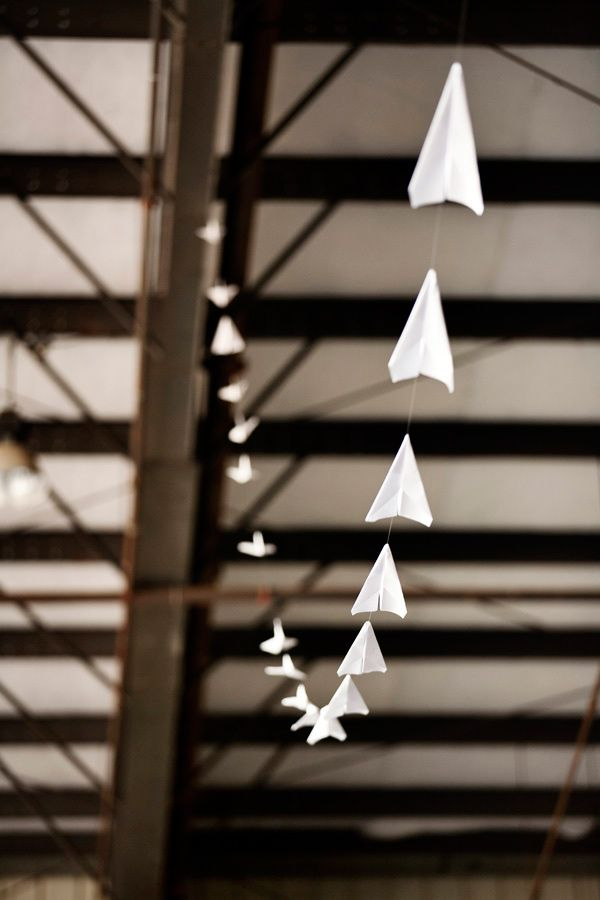 California Air Hanger Wedding by Yuliya M. Photography via ruffledblog: What kid doesn't need this in her room? #Photography #Paper_Planes