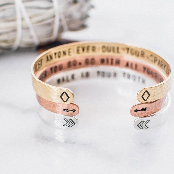 Give the gift of inspiration with these quote cuffs. The three quotes, outlined below, are hand stamped into the bracelets as secret messages. The chevron, arrow and diamond symbols serve as subtle reminders of the quotes within. You can purchase bracelets as a set for stacking, separately, customized or as is. Sterling silver- walk in your truth Brass (gold tone)- dont let anyone ever dull your sparkle Copper- wherever you go, go with all your heart  ♥ Bracelets measures 1/4 x 5.5 and f...