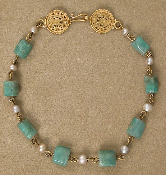 Gold Necklace with Pearls and Stones of Emerald Plasma Date: 6th–7th century Culture: Byzantine Medium: Gold, pearls, emerald plasma Dimensions: Overall: 16 3/4 x 13/16 x 7/16 in. (42.5 x 2.1 x 1.1 cm) Wt: 64g Classification: Metalwork Credit Line: Gift of J. Pierpont Morgan, 1917 Accession Number: 17.190.153