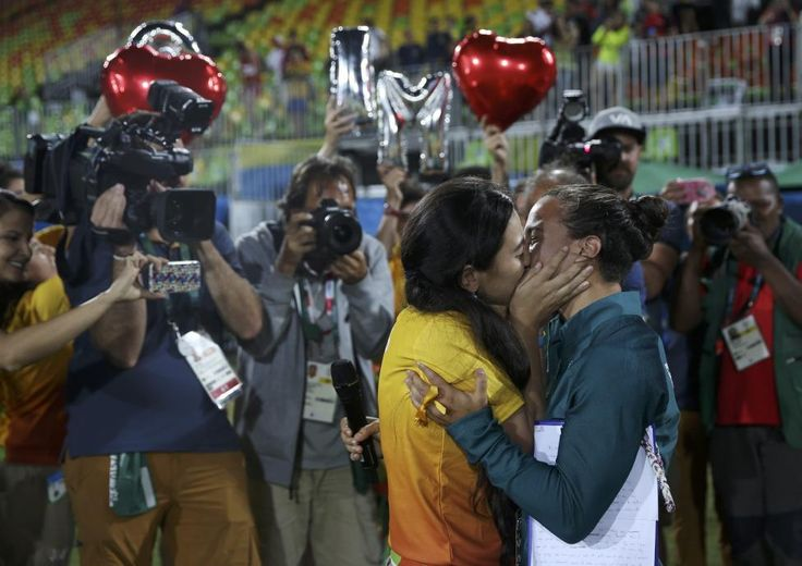 Brazilian women's rugby player Isadora Cerullo melted hearts when she accepted a marriage proposal from her girlfriend at the medals ceremony for the first Olympic rugby sevens competition. Television cameras and photographers captured the moment that Marjorie Enya, a manager at the Deodoro stadium in Rio where the competition was played, took the microphone to pop the question to her girlfriend of two years on the pitch.