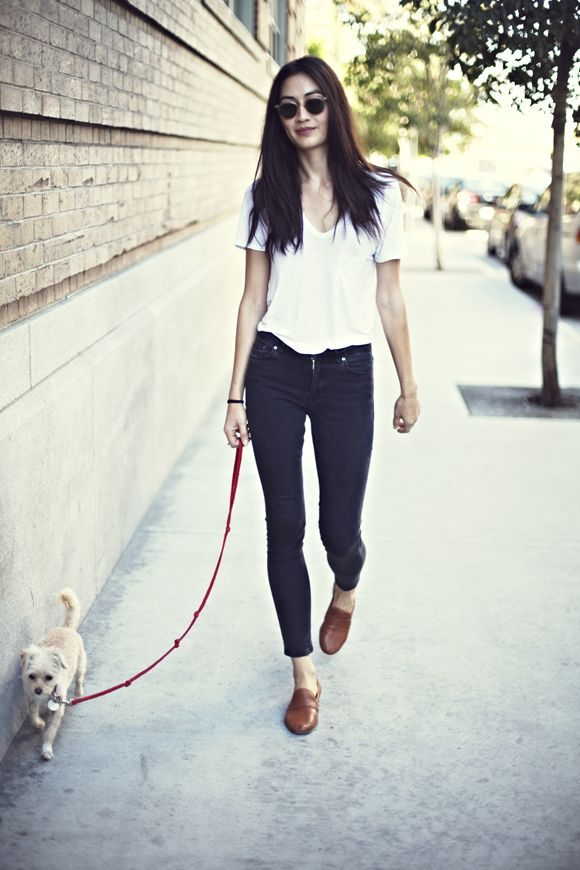 To create an outfit for lunch with friends at the weekend consider teaming a white v-neck t-shirt with black skinny jeans. For footwear go down the classic route with brown leather loafers.  Shop this look for $43:  http://lookastic.com/women/looks/dark-brown-sunglasses-white-v-neck-t-shirt-black-skinny-jeans-brown-loafers/5985  — Dark Brown Sunglasses  — White V-neck T-shirt  — Black Skinny Jeans  — Brown Leather Loafers