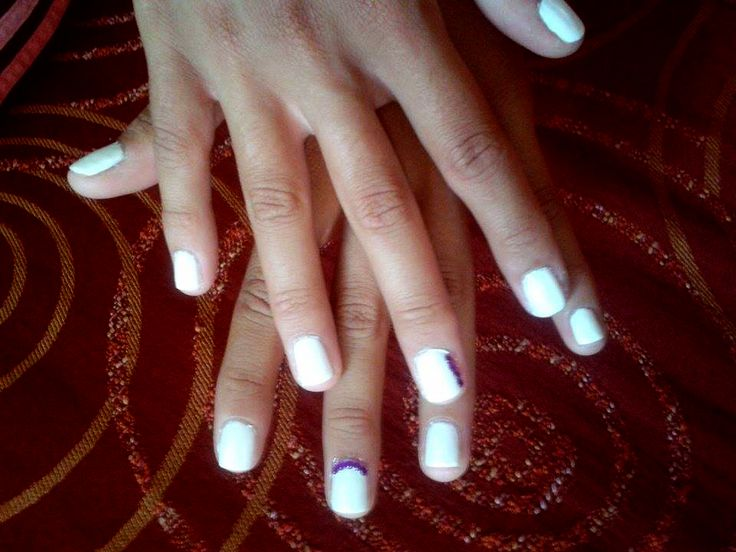White nails with purple strass