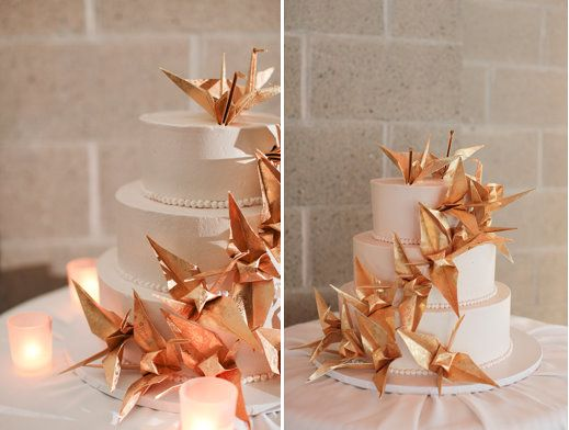 White cake with paper cranes in wedding colours