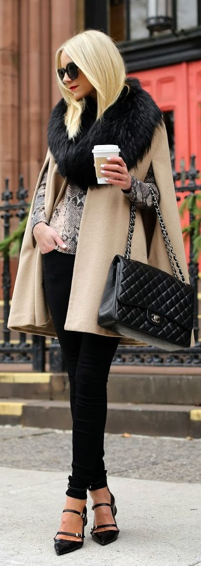 Tan cape blazer + black pant.