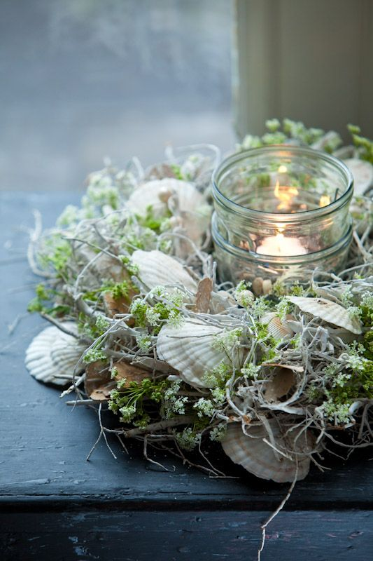 Shells and Spanish Moss around a candle. ..so pretty.
