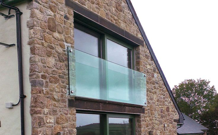 The project involved engineering a frameless glass Juliet balcony, with the minimum fittings possible, to give a clean and clear outlook from the client's bedroom.  The glass ended up at 4.2m long, which is by far the largest single balcony we have achieved and we think makes a fantastic design impact, while keeping the impact on the