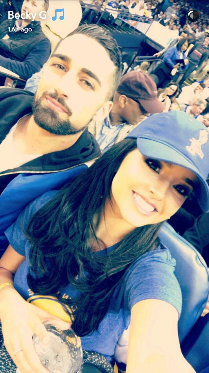 Sebastian Lleget and Becky G at a basketball game. Look how cute they are together. Happy New Year to Becky G and Sebastian Lleget, and both their families.