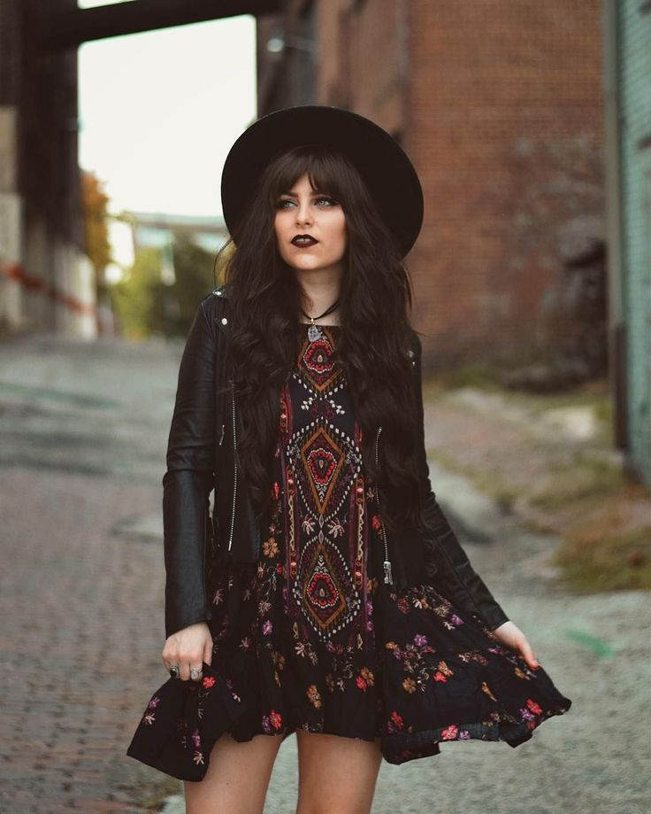 Folksy dress, floppy boho hat, and leather biker jacket paired with dark lips. Such a cool look!