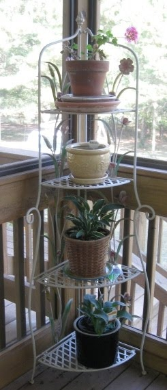 outdoor bakers rack; pot stand; wrought iron; planters; porch/garden design inspiration