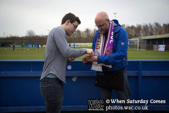 City of Liverpool 6 Holker Old Boys 1, 10/12/2016. Delta Taxis Stadium, North West Counties League Division One. A spectator buying a 'golden goal' ticket at the Delta Taxis Stadium, Bootle, Merseyside before City of Liverpool hosted Holker Old Boys in a North West Counties League division one match. Founded in 2015, and aiming to be the premier non-League club in Liverpool, City were admitted to the League at the start of the 2016-17 season and were using Bootle FC's ground for home…