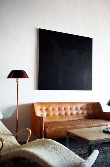 cool leather sofa, minimal painting