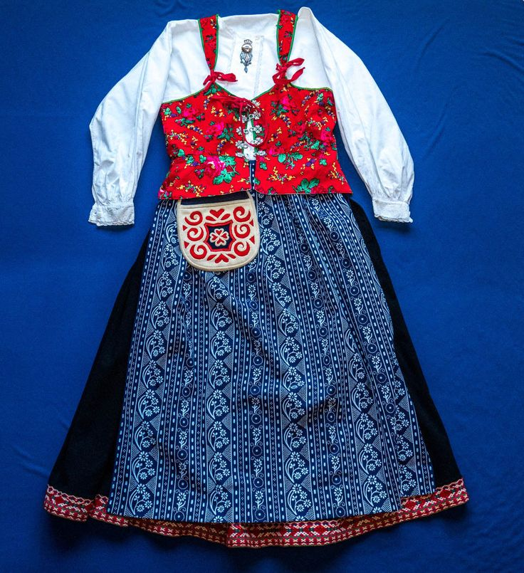 """Costume from Mockfjärd, Gagnef, Dalarna. This ebay listing includes two aprons. The seller describes the blue apron as follows: """"This blue and white apron was sent to us by a relative about 10 years ago. We were told this is a spring and summer apron for the Mockfjärd costume. It looks like a cotton fabric. It also has one long and one short waist tie, so it ties to the side rather than the back."""""""