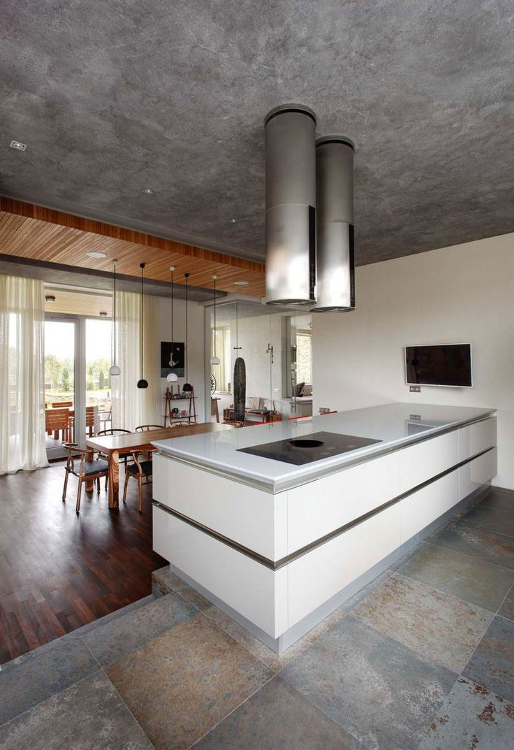Industrial modern kitchen with amore traditional dining room.  Oakland House by Roman Leonidov