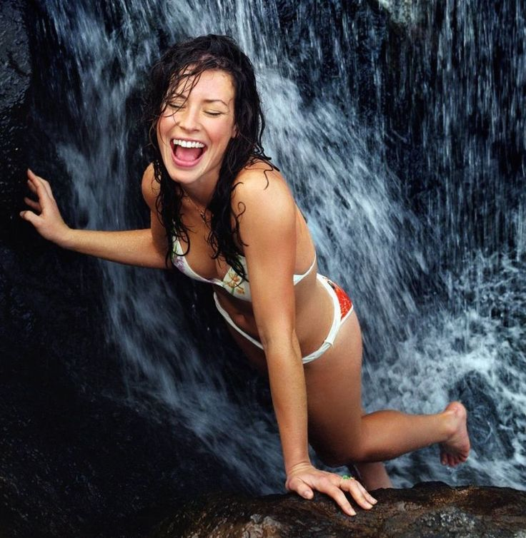 Evangeline Lilly under a waterfall