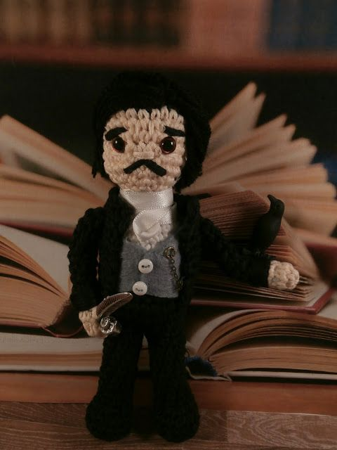 A neatly knitted Edgar Allan Poe doll http://writersrelief.com/