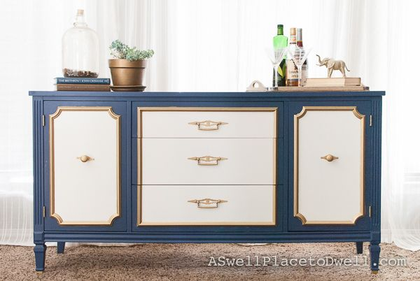 How beautiful is this piece?  Furniture Makeover.  Navy blue, white and gold credenza from www.aswellplacetodwell.com