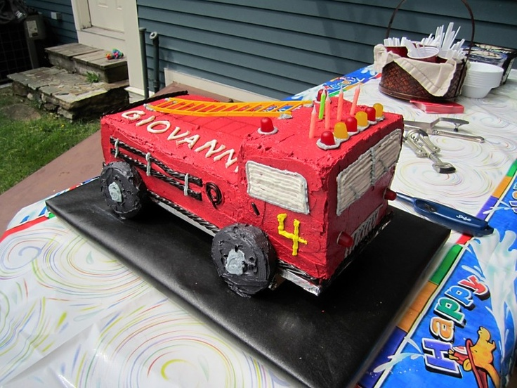 For my little fireman, a fire truck cake with frosting covered doughnut wheels, graham cracker firetruck cookies, a homemade dalmation dog pinata and a real fire truck visit!