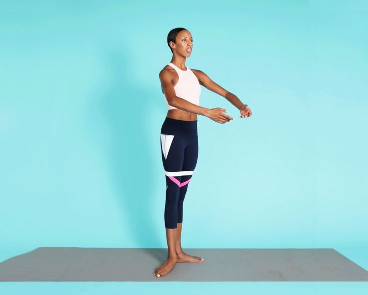 This move will really make your quads and glutes burn. Stand with your heels together and toes turned out about 30 degrees with a circular resistance band looped above your knees. Push your right foot forward up off the ground, keeping both legs straight. Keep your toe pointed as the ball of your foot leaves the floor and then flex it as you pull it back to start. Repeat the same motion out to your side, and then behind you. One time through—front, middle, back—is one rep. Do 12 to 15 reps…