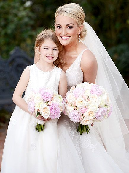 Inside Jamie Lynn Spears's Elegant New Orleans Nuptials | TWO OF A KIND | Look at that mini-me! Spears cuddles close with her 5½-year-old daughter, Maddie Aldridge, who walked down the aisle as the flower girl, carrying a bouquet that matched Mom's.