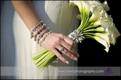 calla lily bouquet with a little bling-could be Blue broach to match the bridesmaids