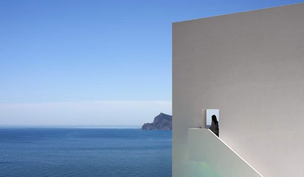 Concrete dwelling merges cliffside on the Balearic Sea