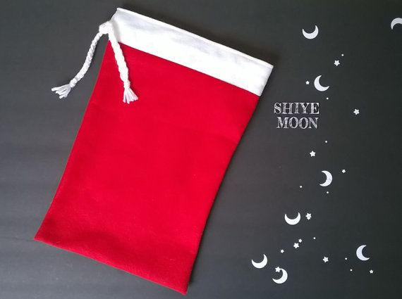 """Santa Bag/Gift Bag/Santa Sack/Christmas Gifts/Drawstring Gift Bag/Gift Sack/Christmas Gift Bags/Red Gift Bags/Customized Gift Bags/Christmas/Custom Gift Bags    Red and white drawstring gift bag. Perfect size for little purses, ponchos, tee shirts, etc.    Bag measurements are: 10 inches by 14 inches.     ******Can be customized or personalized with a name. Purchase the """"customize your order"""" add on and send me a convo with whatever you'd like it to say!****** 