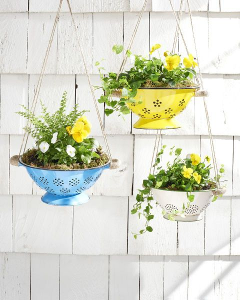 Hanging Colander Planter:  Hanging your plants leaves extra space below; plus, these colorful colanders make the most adorable vessels for flowers.