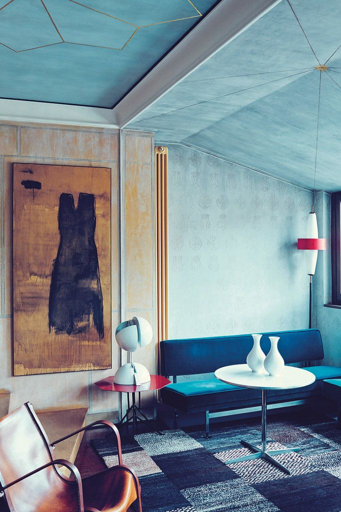 Italian Modern: In gallerist Nina Yashar's home, a painting by Piero Pizzi Cannella hangs near a leather armchair by Jacques Adnet, lamp by Gae Aulenti on a table by Warren McArthur & Frank Lloyd Wright