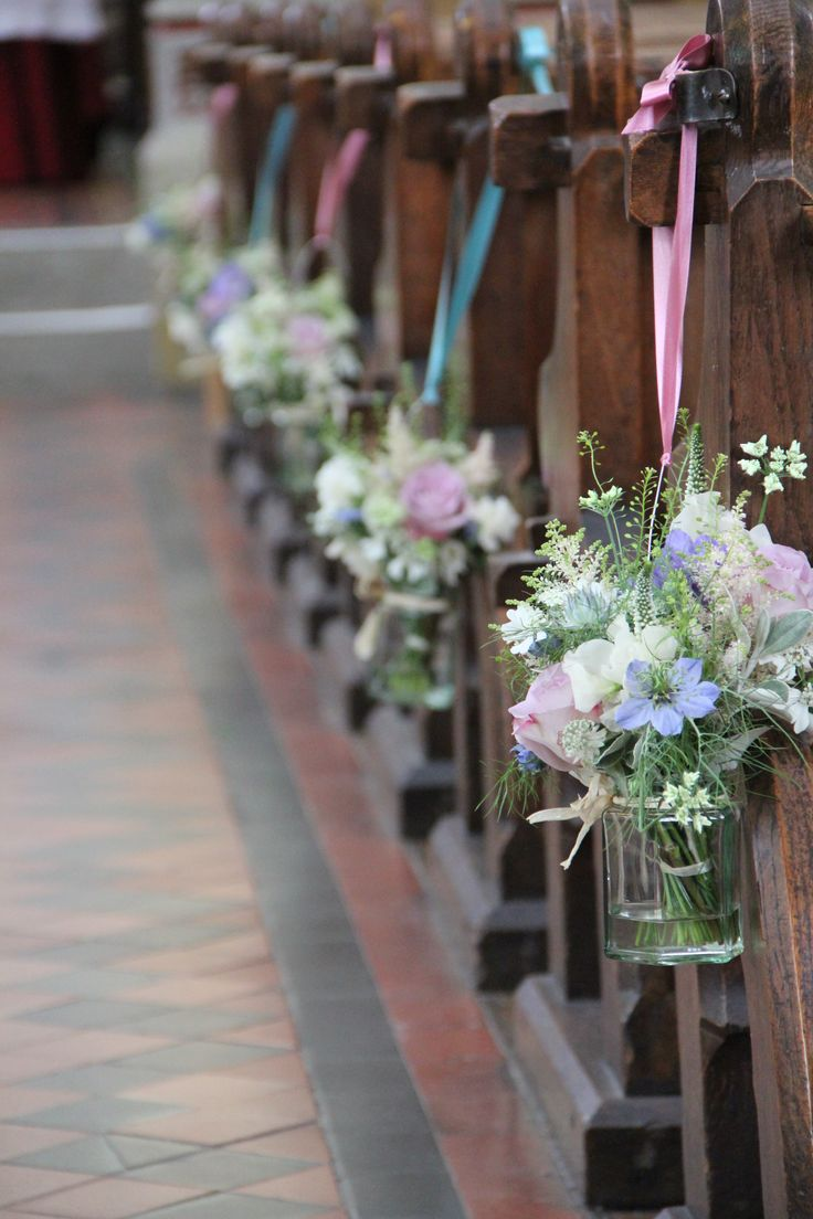 jam jars with posies for the pew ends as Centre pieces
