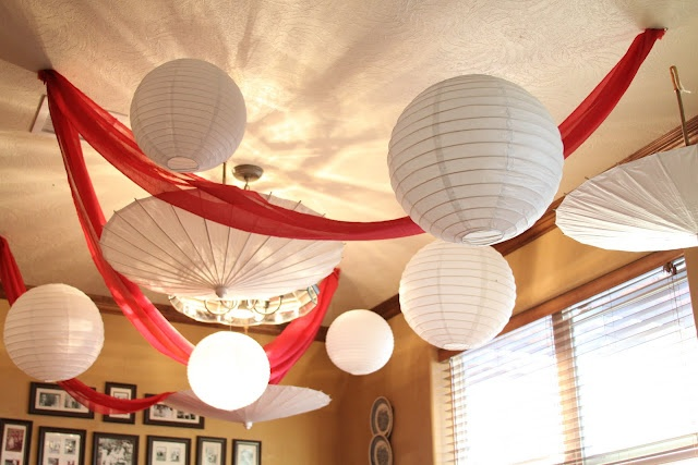 hanging Lanterns and umbrellas...good idea to use parasols as lighting also