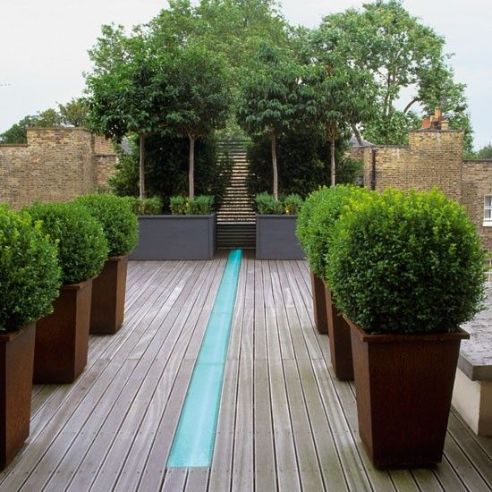 Nice visual idea keeping the feature the same width as the decking but it  looks like a massive trip hazard.