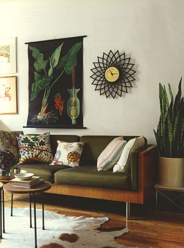 Vintage botanical charts add an authentic feel to this retro space. A tropical touch in the cushions sets it off perfectly.
