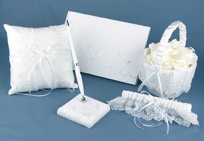 Embroidered lace and iridescent sequins and satin bows beautifully decorate this white satin wedding accessory collection. The silver lined guest book has space for over 700 guest entries and the Pen set features silver accents.    A Dream Come True Wedding Accessory Collection