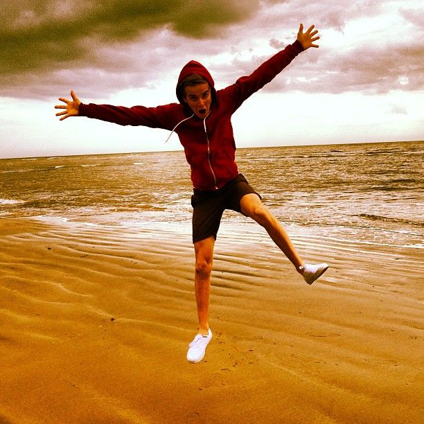 Joe Sugg. Standard beach jump photo.