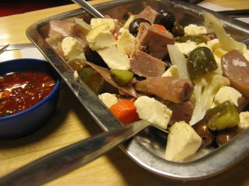 "Pichanga....(It is a popular appetizer creole, is made with cubed beef, olives, pickles, cheese, tomato, avocado. The idea is to ""pick"" the pichanga pending the strongest dish, so it is an opportunity to share among friends)."