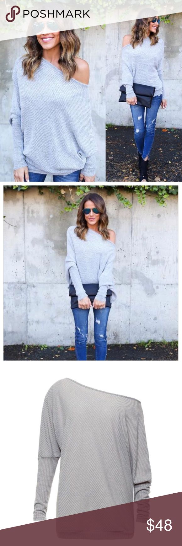 """Cozy Off The Shoulder Sweater This Cozy Sweater is to die for, so soft to the touch! The ribbed body and cowl neck can be worn on or off the shoulder! We're dreaming of a cozy fall in this gem. The long sleeves are easy to pull up or down and the asymmetrical hem is on trend. Off One Shoulder Dolman Fit Cotton  Size Small: 24"""" from shoulder to hem Model is 5'4"""" and wears a Small Sizing chart above for reference. Also available in black & burgundy 🙂REASONABLE offers welcome Bundle of  1 will…"""