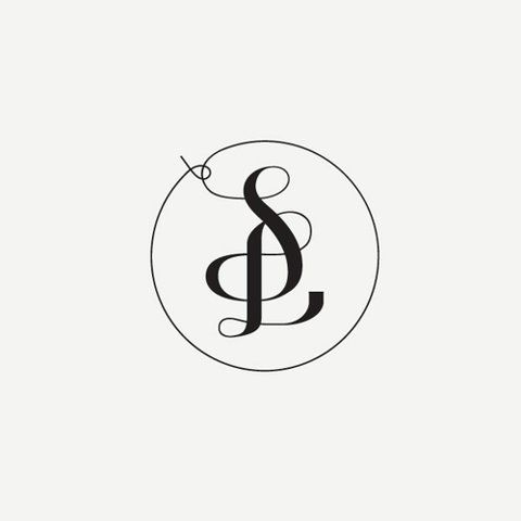 i love the idea of this monogram. simple and modern but still feminine. could maybe be tied in somehow with the bow..?