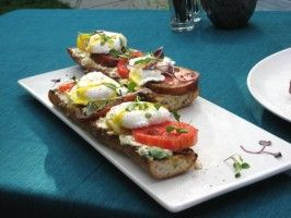 Poached Eggs on Toasted Baguette with Goat Cheese, and Black Pepper Vinaigrette from CookingChannelTV.com