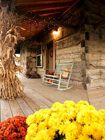The fall inspired porch of the dovetail square log cabinCountry Porches, Rocks Chairs, Dreams Porches, Country Life, Fall Porches, Fall Flower, Logs House, Logs Cabin, Front Porches