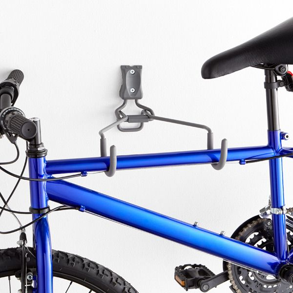 Use our elfa utility Horizontal Bike Hook to store your bike in a garage or utility room.  It securely holds one bike (up to 50 lbs.) by the frame to help save space.  It can be mounted directly to a wall stud or used in conjunction with an elfa Track.