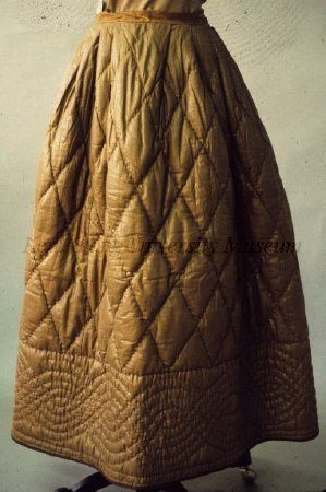 Brown polished cotton quilted petticoat, dated 1840-1849, American. Kent State University Museum collection: 1983.001.0084