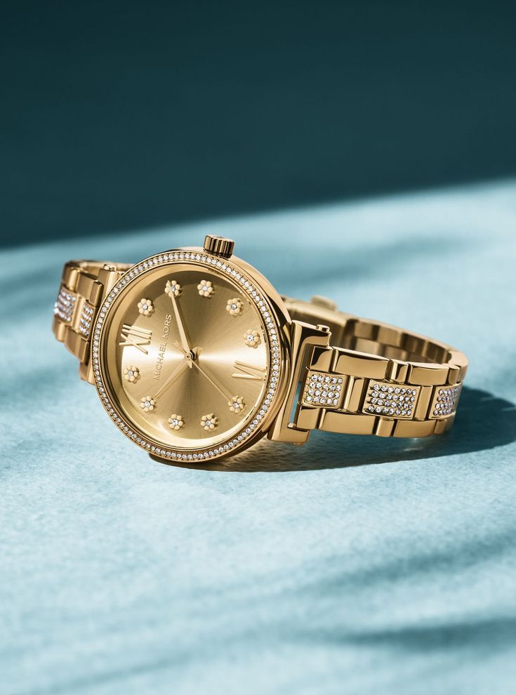 610b247fb From Michael Kors, the Sofie Pavé Gold-Tone Watch. Elevate your look with  the Sofie, a glamorous analog watch adorned with shimmering pavé crystals.