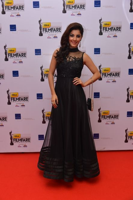 Isha Talwar carrying a sequins bag at the FIlmFare South Awards, 2013
