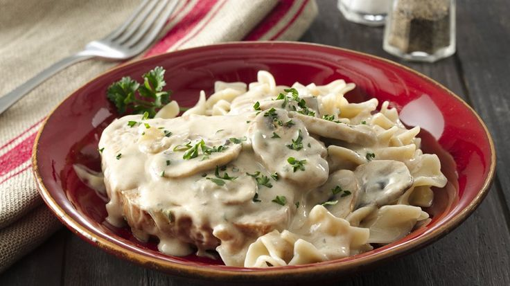Smothered in a creamy sauce with mushrooms, these pork chops and pasta made with Ultimate Hamburger Helper® will be a winner in your family!