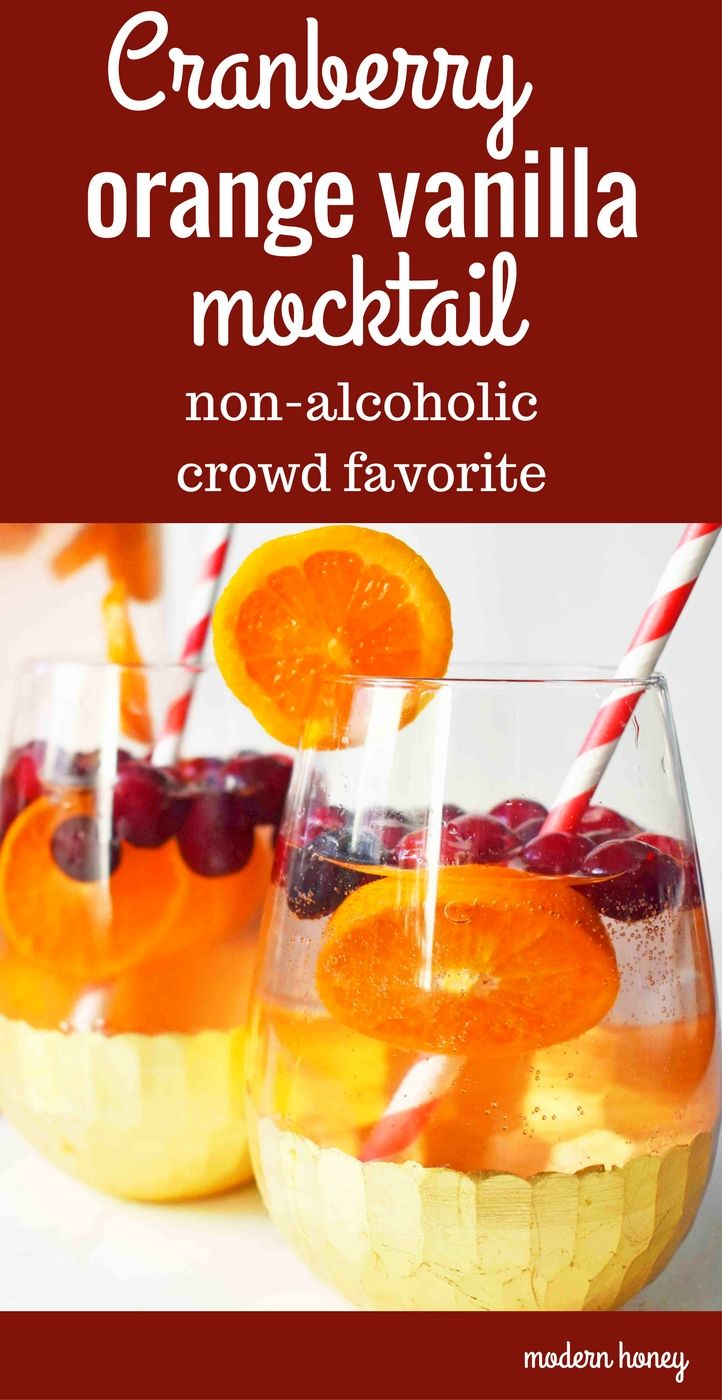 A non-alcoholic, crowd pleasing Cranberry Orange Vanilla Mocktail perfect for the holidays. A drink made with holiday favorite, Cranberry Sprite, fresh orange slices, fresh cranberries, and vanilla syrup. www.modernhoney.com