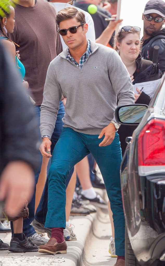 From his sweater/button-down combo, to his colored chinos, to his vintage square shades, Zac Efron's style is totally dapper!
