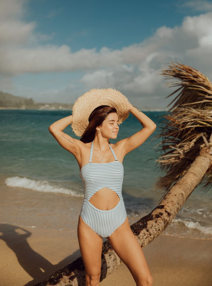 SHOP SWIMSUITS HERE! When you get a two piece look with the functionality and slimming vibes of a one piece, you can't go wrong! Say Aloha to our Breezy Stripe One Piece Cut Out Swimsuit. The stripes flatter and lengthen the body and the sporty style of the swim keeps you looking and feeling good. To see more from our 2018 swim collection, head to albionfit.com #swimsuit #swims #onepieceswimsuits #beachy #beach #modestswimsuits