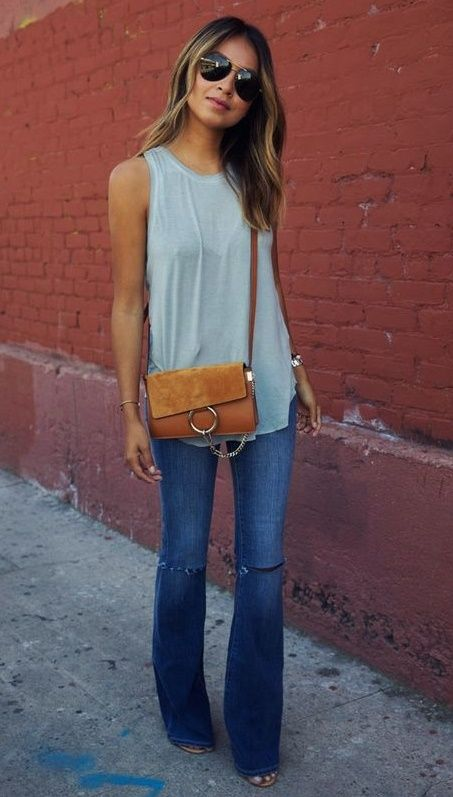 Love the simple top! Flare jeans like but without holes in the knees.